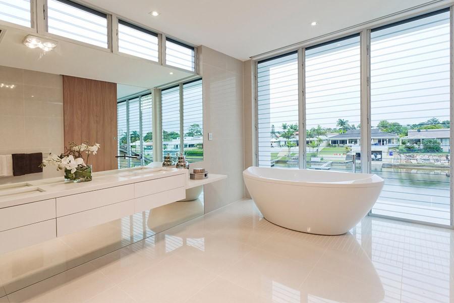 Modern, Spacious bathroom with a bath and a big window   Kitchen U