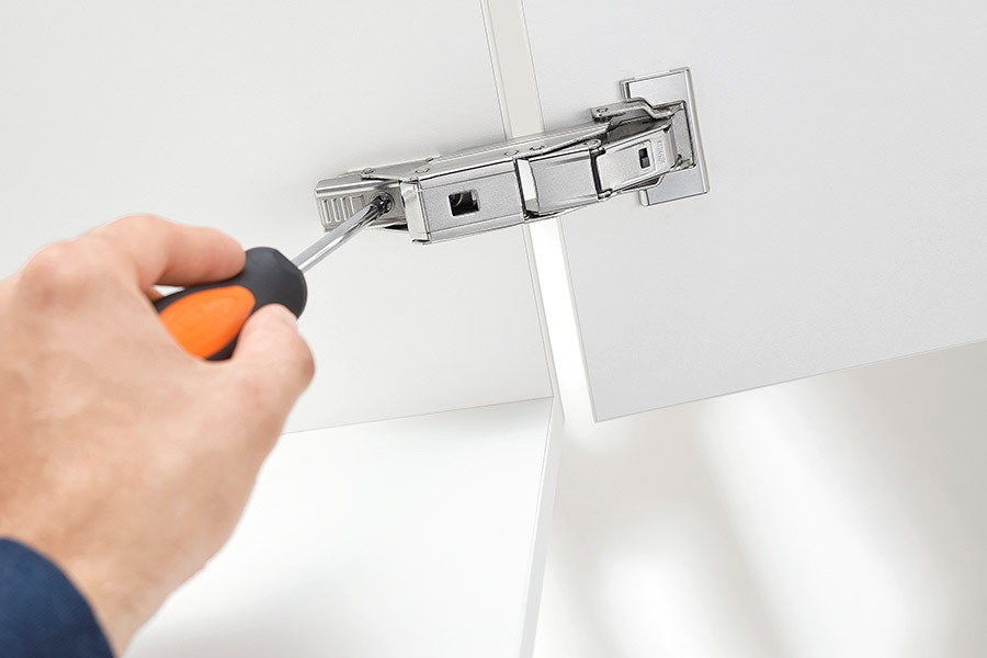 Tradie fixing a cabinet | Ktichen U